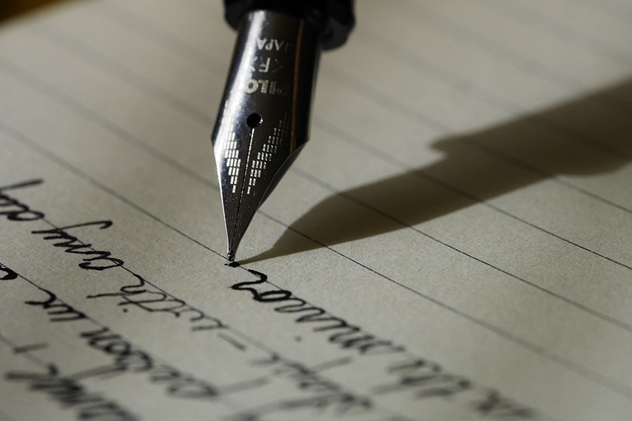 Pen writing content marketing document
